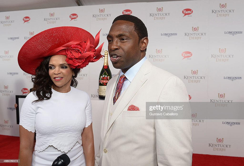 Cassandra Johnson and Avery Johnson toast with Moet Chandon at the 140th Kentucky Derby at Churchill Downs on May 3 2014 in Louisville Kentucky