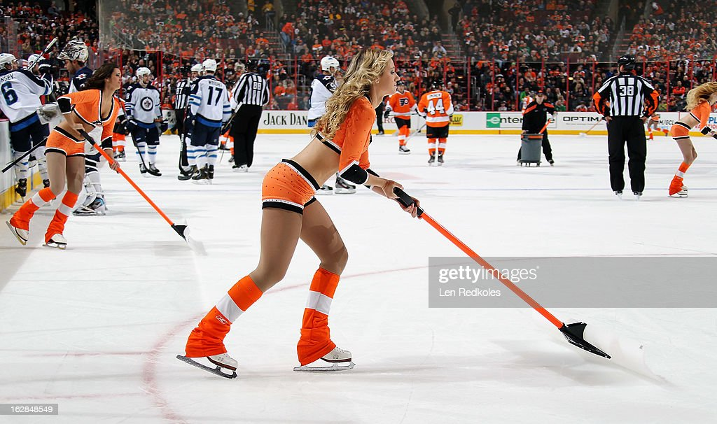 Cassandra Latsios of the Philadelphia Flyers ice girls cleans the ice during a timeout against the Winnipeg Jets on February 23, 2013 at the Wells Fargo Center in Philadelphia, Pennsylvania.