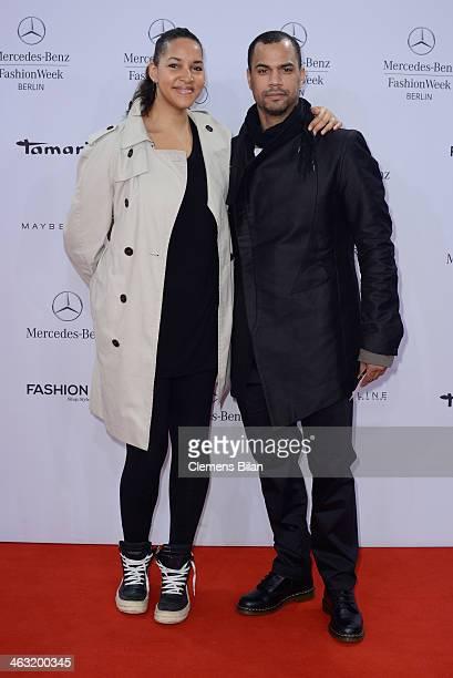 Cassandra Steen and Patrice Bouedibela attend the Umasan show during MercedesBenz Fashion Week Autumn/Winter 2014/15 at Brandenburg Gate on January...