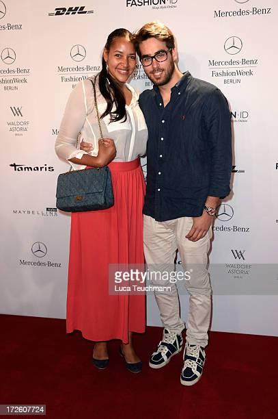 Cassandra Steen and Stephan Kocijan attend the Schumacher Show during MercedesBenz Fashion Week Spring/Summer 2014 at the Brandenburg Gate on July 4...