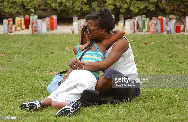 Cassandra Webster and her 9yearold daughter Myieh share a tearful hug near a makeshift shrine for slain 5yearold Samantha Runnion July 19 2002 in...