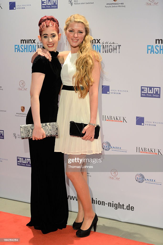 Cassandra Wyss (l) and Eva Friedl (r) pose during the Minx fashion night at Residenz on October 12, 2013 in Wuerzburg, Germany. The benefit of the charity gala is for the aid organisation 'Sauti Kuu' of Auma Obama. Behind the fashion label Minx stands Eva Lutz.