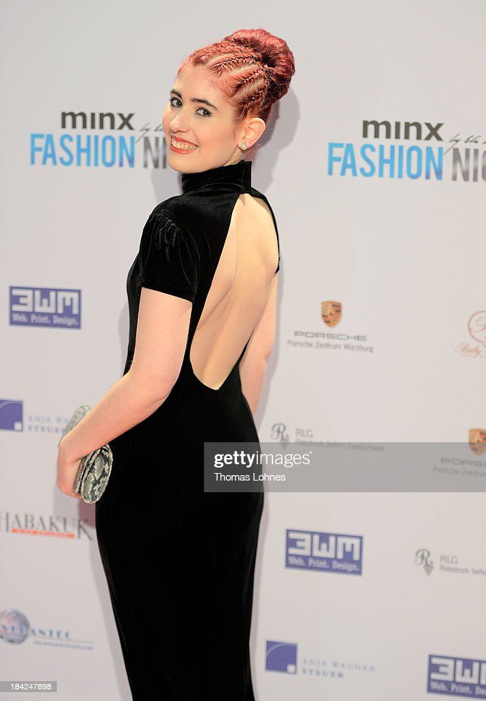 Cassandra Wyss poses during the Minx fashion night at Residenz on October 12, 2013 in Wuerzburg, Germany. The benefit of the charity gala is for the aid organisation 'Sauti Kuu' of Auma Obama. Behind the fashion label Minx stands Eva Lutz.