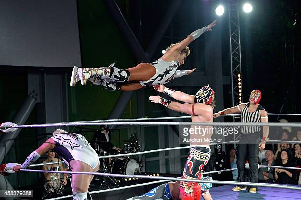 Cassandro El Exotico and Magnus perform onstage during the EXOTICOS VS LUCHADORES Lucha Libre Show hosted by La Fondation Cartier in Paris on...