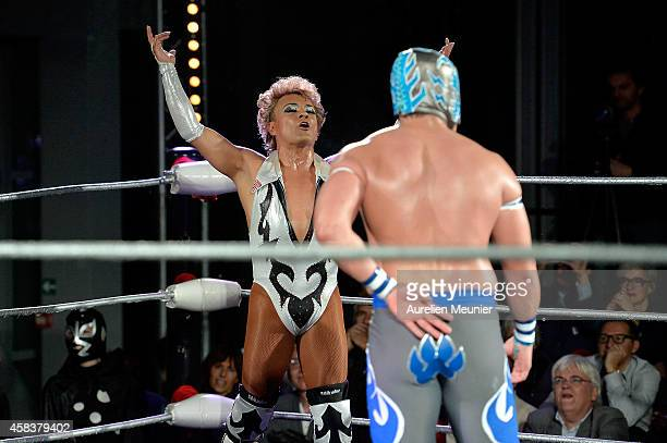 Cassandro El Exotico and Puma King perform onstage during the EXOTICOS VS LUCHADORES Lucha Libre Show hosted by La Fondation Cartier in Paris on...