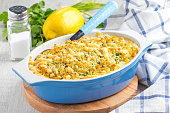 Casserole with crispy crumble, potato gratin, baked meat butter cheese dish, delicious homemade dinner