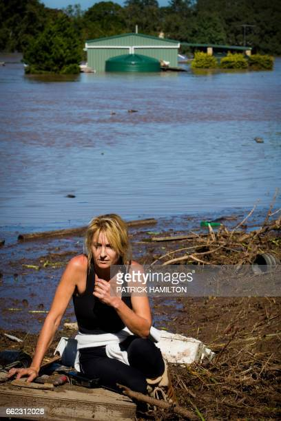Cassey Bentley reacts to the discovery of her flooded home in North MacLean Brisbane on April 1 which was submerged under floodwaters caused by...