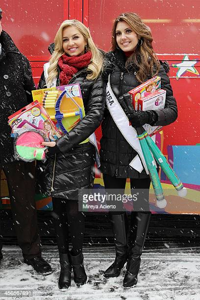 Cassidy Wolf and Erin Brady attend CitySightseeing New York 2013 holiday toy drive at PAL's Harlem Center on December 14 2013 in New York City