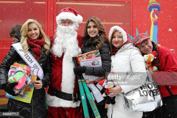 Cassidy Wolf Santa Claus Erin Brady Mrs Claus and Anthony Laciura attend CitySightseeing New York 2013 holiday toy drive at PAL's Harlem Center on...