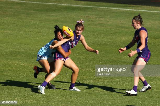 Cassie Davidson of the Dockers gets tackled by Darcy Vescio of the Blues during the round six AFL Women's match between the Fremantle Dockers and the...