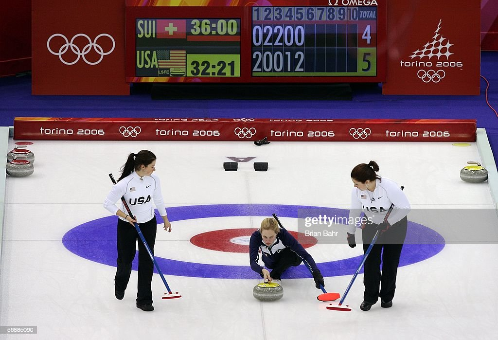 Cassie Johnson of the United States delivers her stone as Courtney George and Maureen Brunt prepare to sweep during a preliminary round of women's...