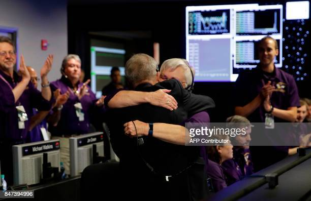 Cassini Project Manager Earl Maize and Spacecraft Operations Team Manager Julie Webster hug in mission control at NASA's Jet Propulsion Laborator...