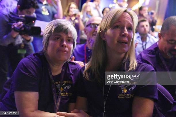 Cassini science team members Nora Alonge and Jo Pitesky react as the final loss of signal from the Cassini spacecraft is confirmed indicating...
