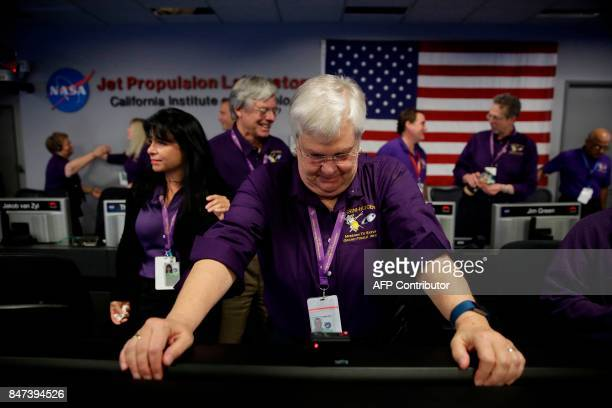 Cassini Spacecraft Operations Team Manager Julie Webster gets emotional in mission control at NASA's Jet Propulsion Laboratory September 15 after...
