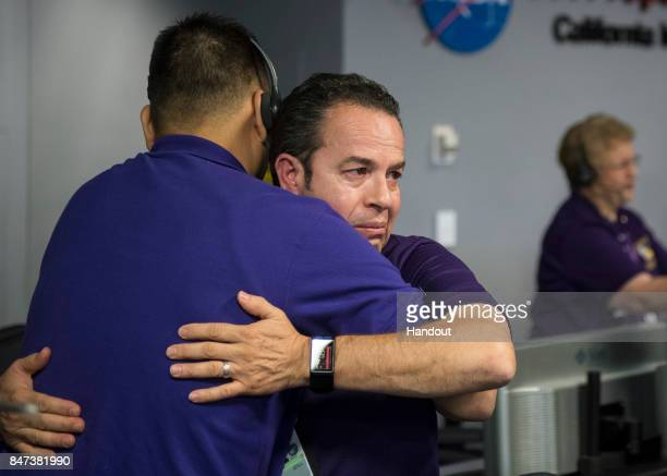 Cassini team members embrace after the spacecraft was deliberately plunged into SaturnSeptember 15 2017 at NASA's Jet Propulsion Laboratory in...