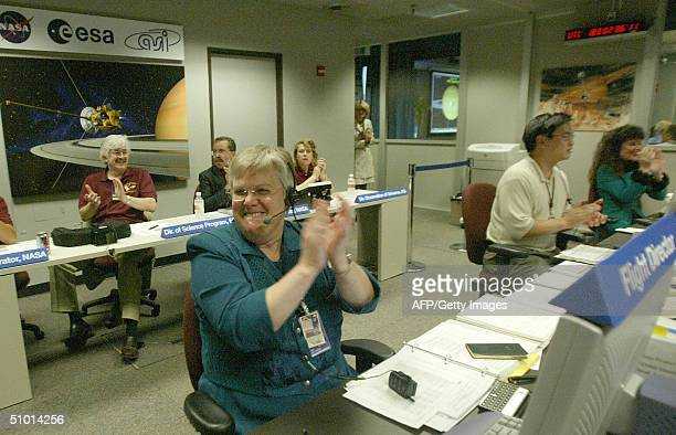 CassiniHuygens flight director Julie Webster reacts as the burn of the retrorockets to insert the spacecraft into the orbit of Saturn begins 30 June...