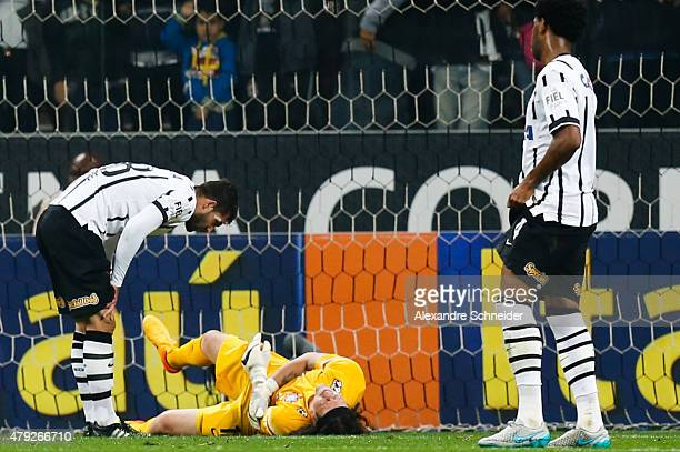 Cassio goalkeeper of Corinthians goes down injured during the match between Corinthians and Ponte Preta for the Brazilian Series A 2015 at Arena...