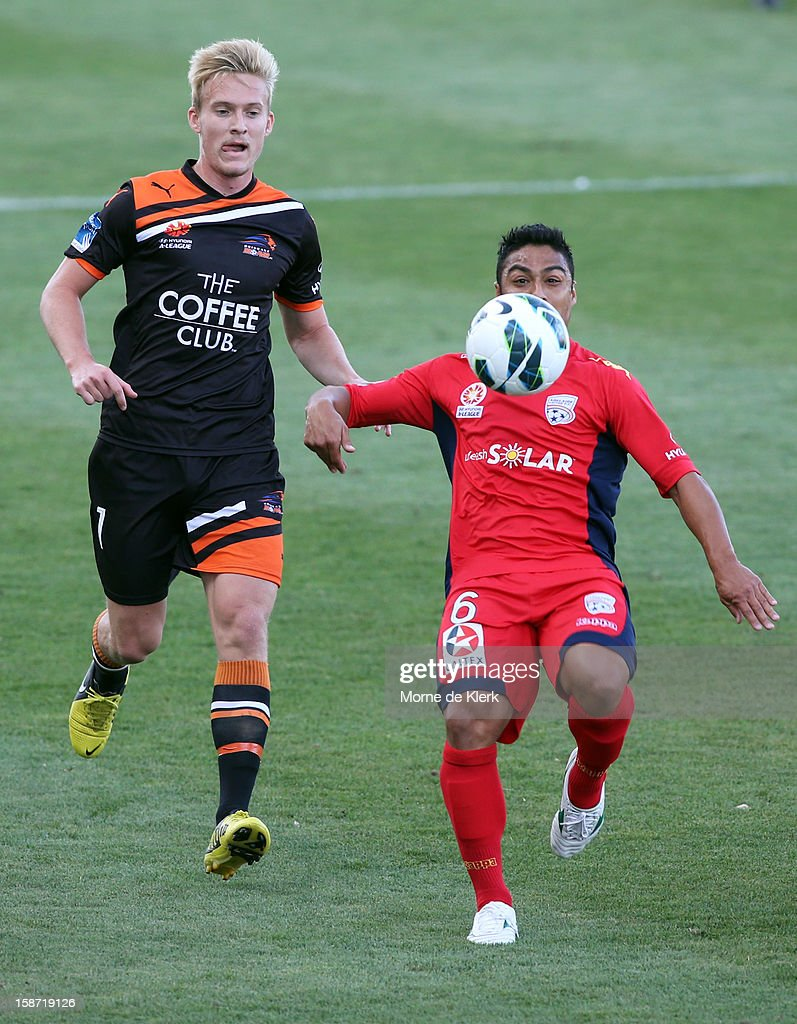 Cassio (R) of Adelaide keeps his eyes on the ball during the round 13 A-League match between Adelaide United and the Brisbane Roar at Hindmarsh Stadium on December 26, 2012 in Adelaide, Australia.