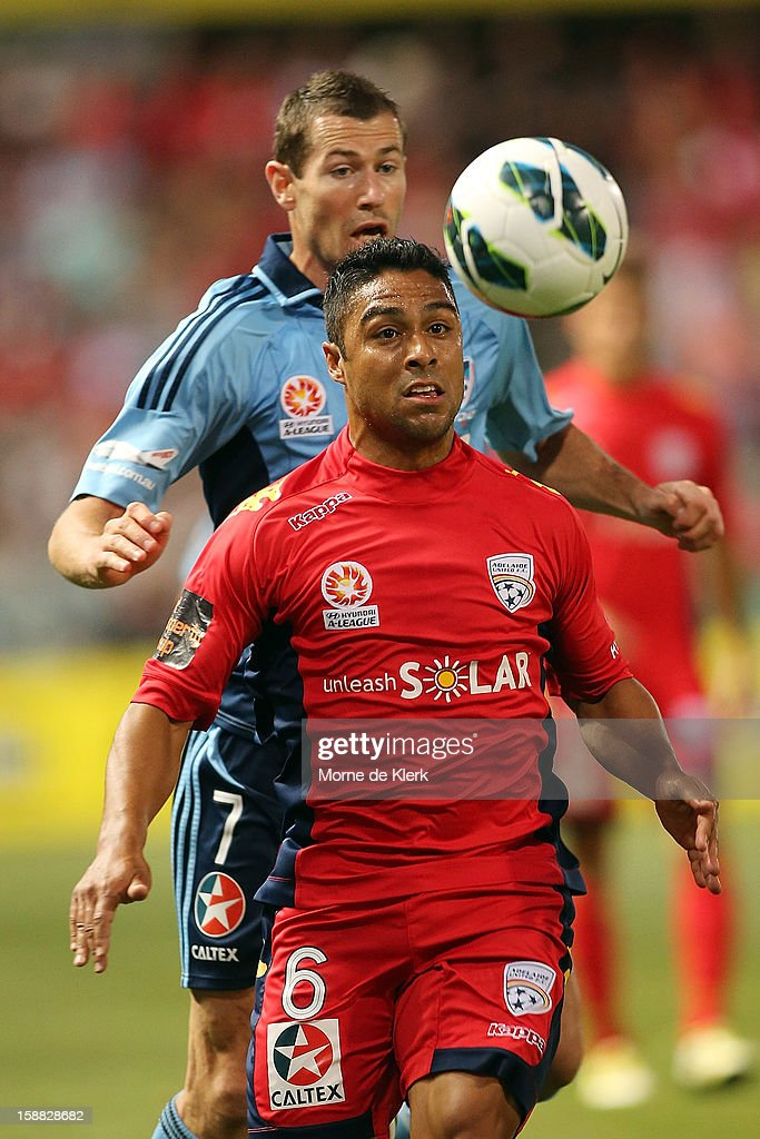 Cassio of Adelaide wins the ball in front of <a gi-track='captionPersonalityLinkClicked' href=/galleries/search?phrase=Brett+Emerton&family=editorial&specificpeople=206493 ng-click='$event.stopPropagation()'>Brett Emerton</a> of Sydney during the round 14 A-League match between Adelaide United and Sydney FC at Hindmarsh Stadium on December 31, 2012 in Adelaide, Australia.