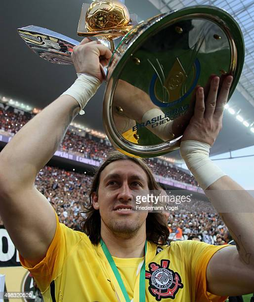 Cassio of Corinthians celebrates with the trophy after winning the match between Corinthians and Sao Paulo for the Brazilian Series A 2015 at Arena...