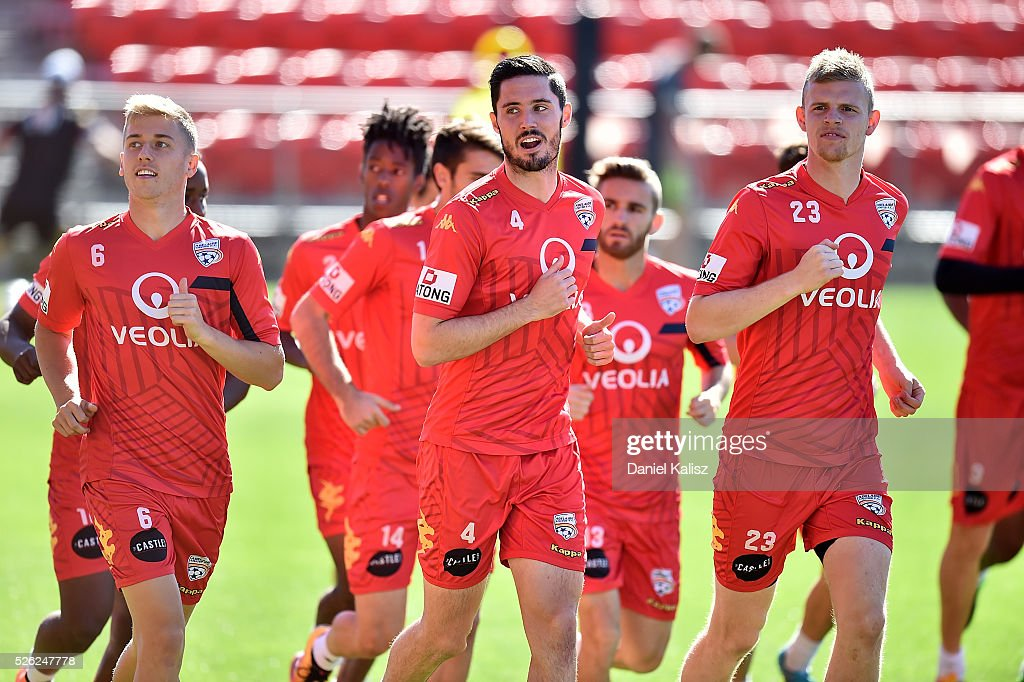 Cassio Oliveira, Dylan McGowan and Jordan Elsey of United warm up during an Adelaide United A-League training session at Coopers Stadium on April 30, 2016 in Adelaide, Australia.