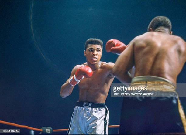 Cassius Clay and Archie Moore during the fight at the Sports Arena on November 15 1962 in Los Angeles California Cassius Clay won by TKO at 135 in...