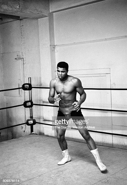 Cassius Clay between training sets at the Main Street Gym preparing for his bout against Archie Moore October 1962 in Los Angeles California