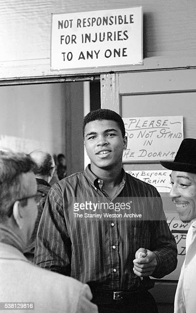Cassius Clay between training sets talking to some folks at the Main Street Gym preparing for his bout against Archie Moore October 1962 in Los...