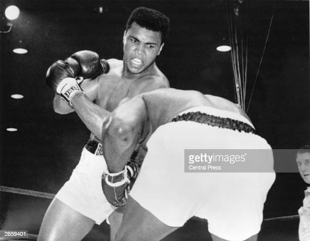 Cassius Clay in action against Sonny Liston during their heavyweight title fight at Miami Beach Florida Clay won the contest becoming world champion...