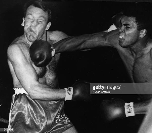 Cassius Clay lands a right to the head of Brian London during their World Heavyweight Title fight at Earls Court Ali won by a knockout in the third...