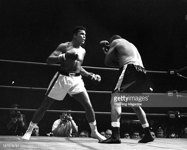 Cassius Clay looks to throw a left to Archie Moore during the fight at the Sports Arena on November 151962 in Los Angeles California Cassius Clay won...