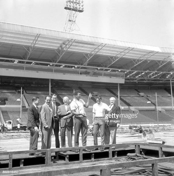 Cassius Clay the American heavyweight who is unbeaten in the ring with his promoter Jack Solomons at Wembley Stadium in London to inspect progress on...