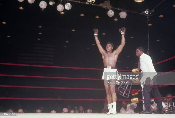 Cassius Clay throws his hands up in victor over Sonny Liston not pictured in a World Heavyweight Title fight February 25 1964 at Convention Hall in...