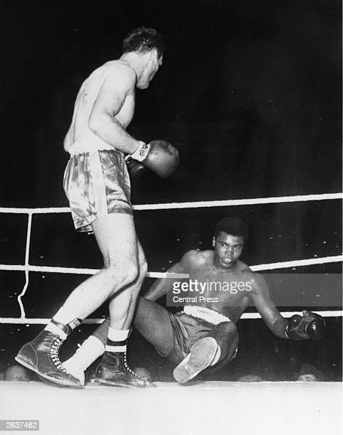 Cassius Clay world heavyweight champion is floored by British boxer heavyweight champion Henry Cooper during their fight at Wembley Stadium Despite...