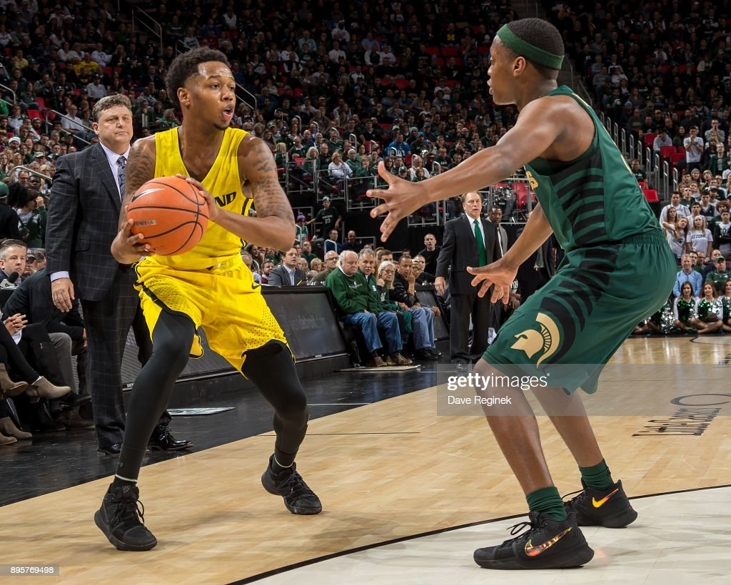Cassius Winston #5 of the Michigan State Spartans defends against Nick Daniels #2 of the Oakland Golden Grizzlies during game two of the Hitachi College Basketball Showcase at Little Caesars Arena on December 16, 2017 in Detroit, Michigan. The Spartans defeated the Grizzles 86-73.