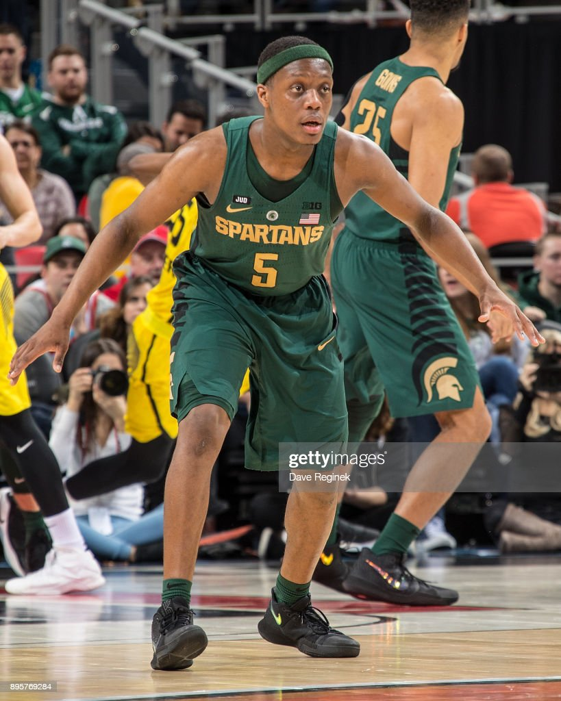 Cassius Winston #5 of the Michigan State Spartans ''defends against Oakland Golden Grizzlies during game two of the Hitachi College Basketball Showcase at Little Caesars Arena on December 16, 2017 in Detroit, Michigan. The Spartans defeated the Grizzles 86-73.