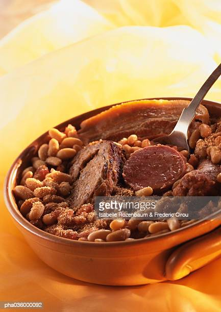 Cassoulet (french meat and bean stew) in casserole dish, close-up