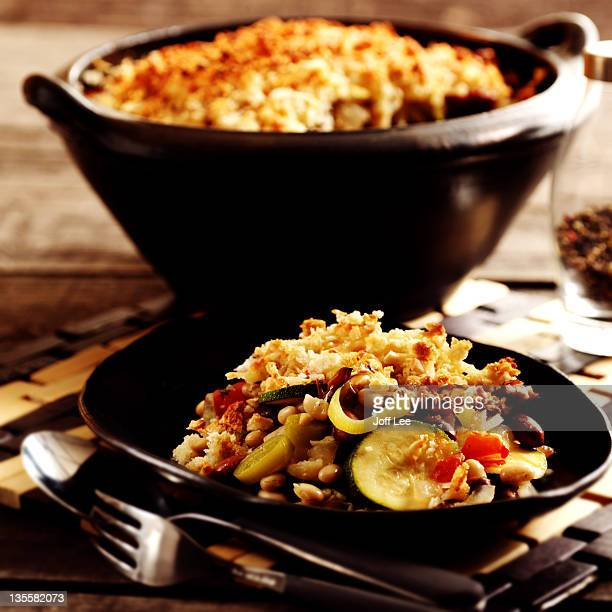 Cassoulet in dish with portion on plate