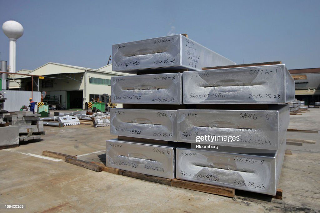 Cast aluminum blocks sit stacked at the Novelis Inc. production facility in Yeongju, South Korea, on Thursday, May 23, 2013. Novelis plans to boost research and development staff by 40 percent as the biggest supplier of flat-rolled aluminum products to global carmakers seeks to increase recycled content in products used in cans and vehicles. Photographer: Woohae Cho/Bloomberg via Getty Images