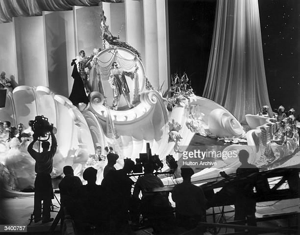 Cast and crew filming a scene for 'The Great Ziegfeld' a biopic of the Broadway impresario Florenz Ziegfeld directed by Robert Z Leonard for MGM