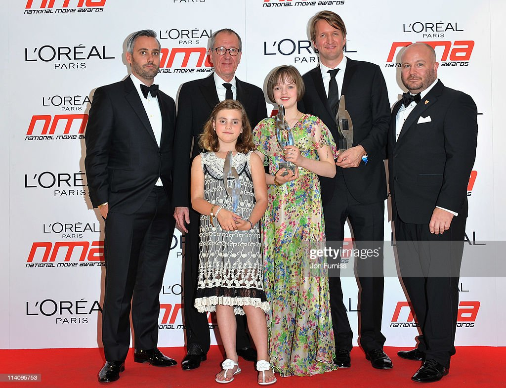 Cast and crew from The Kings Speech including Geoffery Rush Tom Hooper Freya Wilson and Ramona Marquez pose in the press room at the L'Oreal National...