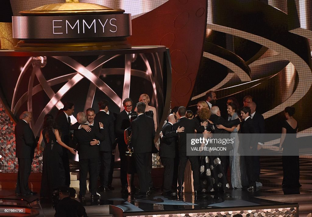Cast and crew from the''Game of Thrones' celebrate the award for Outstanding Drama Series during the 68th Emmy Awards show on September 18, 2016 at the Microsoft Theatre in downtown Los Angeles. / AFP / Valerie MACON