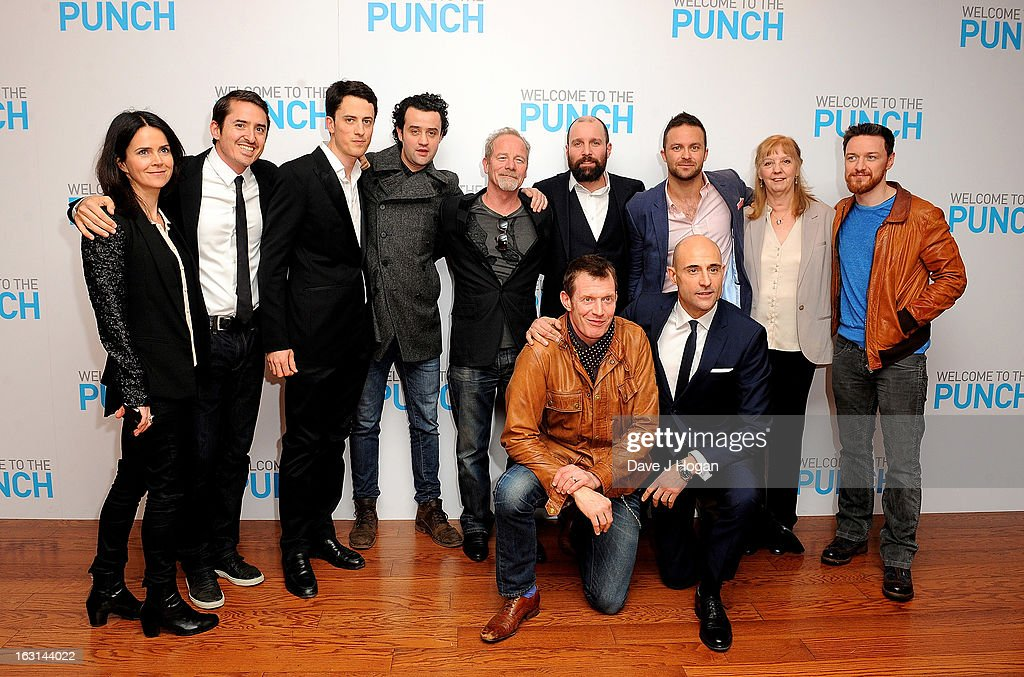 Cast and crew including Liza Marshall (L) (from fourth left) Danny Mays, Peter Mullan, Johnny Harris, director Eran Creevy, James McAvoy (R) Jason Flemyng and Mark Strong (front) attend the 'Welcome To The Punch' UK Premiere at the Vue West End on March 5, 2013 in London, England.