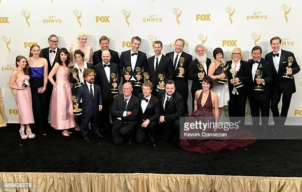 Cast and crew members of 'Game of Thrones' winners of Outstanding Drama Series pose in the press room at the 67th Annual Primetime Emmy Awards at...