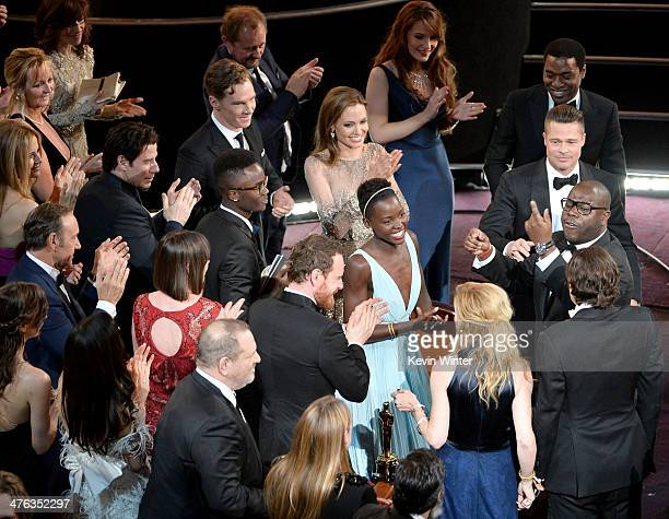 Cast and crew of Best Picture winner '12 Years A Slave' celebrate their win during the Oscars at the Dolby Theatre on March 2 2014 in Hollywood...
