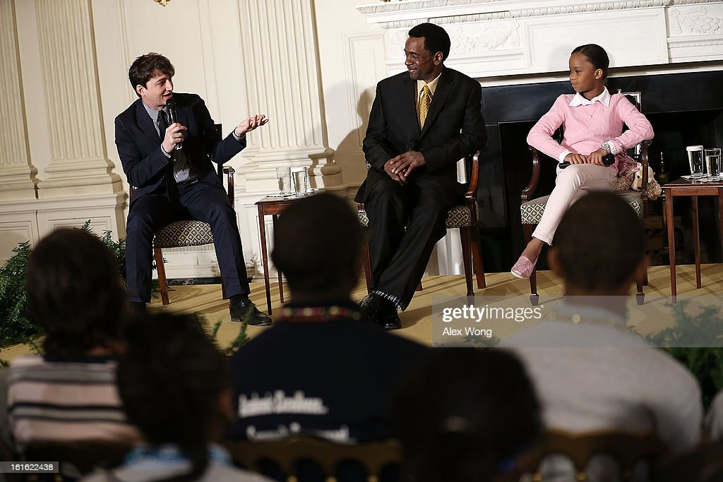 Cast and crew of the film Beasts of the Southern Wild, director Benh Zeitlin (L) speaks as stars Dwight Henry (2nd L) and Quvenzhane Wallis (R) listen during an interactive student workshop at the State Dining Room of the White House February 13, 2013 in Washington, DC. U.S. first lady Michelle Obama hosted middle and high school students from the DC area and New Orleans to participate in the event.