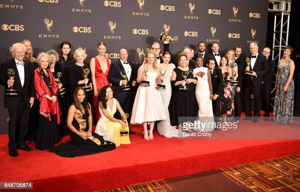 Cast and crew of 'The Handmaid's Tale' winner of the Outstanding Drama Series award pose in the press room during the 69th Annual Primetime Emmy...