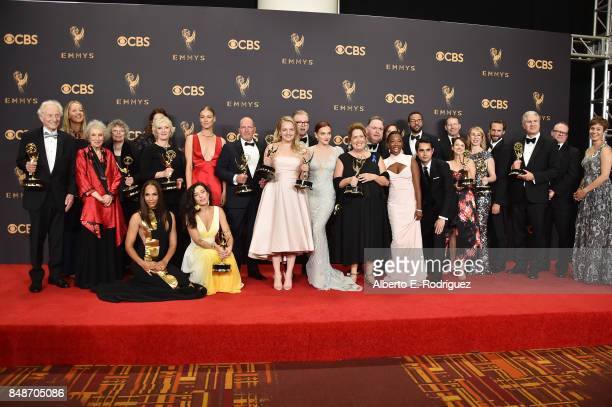 Cast and Crew of 'The Handmaid's Tale' winners of Outstanding Drama Series pose in the press room during the 69th Annual Primetime Emmy Awards at...