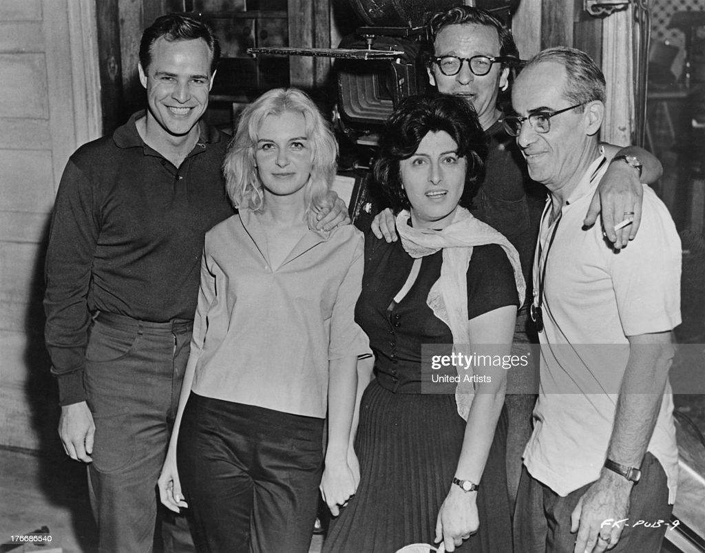 Cast and crew on the set of 'The Fugitive Kind', New York, USA, 1959. Left to right: <a gi-track='captionPersonalityLinkClicked' href=/galleries/search?phrase=Marlon+Brando&family=editorial&specificpeople=85897 ng-click='$event.stopPropagation()'>Marlon Brando</a> (1924 - 2004), <a gi-track='captionPersonalityLinkClicked' href=/galleries/search?phrase=Joanne+Woodward&family=editorial&specificpeople=211476 ng-click='$event.stopPropagation()'>Joanne Woodward</a>, <a gi-track='captionPersonalityLinkClicked' href=/galleries/search?phrase=Anna+Magnani&family=editorial&specificpeople=241458 ng-click='$event.stopPropagation()'>Anna Magnani</a> (1908 - 1973), director <a gi-track='captionPersonalityLinkClicked' href=/galleries/search?phrase=Sidney+Lumet&family=editorial&specificpeople=214143 ng-click='$event.stopPropagation()'>Sidney Lumet</a> (1924 - 2011), and cinematographer Boris Kaufman (1897 - 1980).
