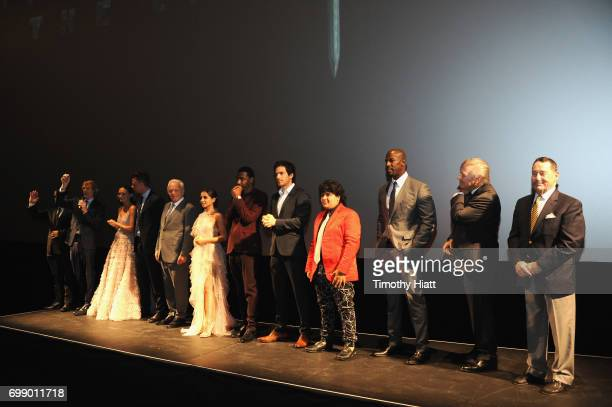 Cast and Crew speak onstate at the US premiere of 'Transformers The Last Knight' at the Civic Opera House on June 20 2017 in Chicago Illinois